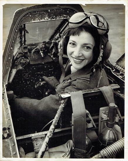Jackie Moggridge in plane cockpit 1953